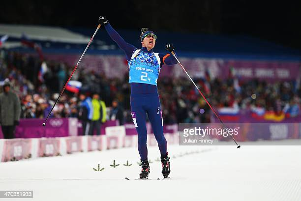 Emil Hegle Svendsen of Norway celebrates winning gold in the 2 x 6 km Women 2 x 7 km Men Mixed Relay during day 12 of the Sochi 2014 Winter Olympics...