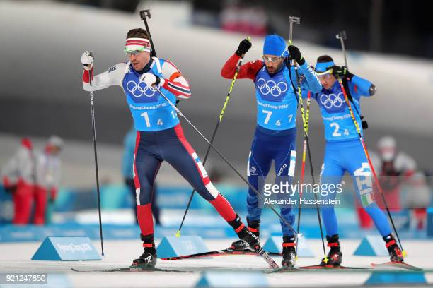 Emil Hegle Svendsen of Norway Martin Fourcade of France and Dominik Windisch of Italy compete in the final leg during the Biathlon 2x6km Women 2x75km...