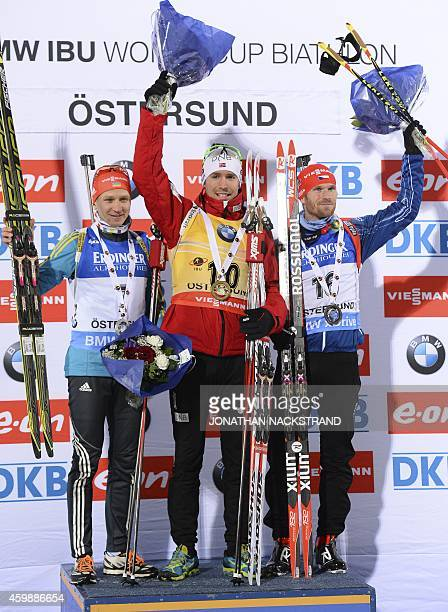 Emil Hegle Svendsen of Norway stands on the podium with secondplaced Serhiy Semenov of Ukraine and thirdplaced Michal Slesinger of Czech Republic...