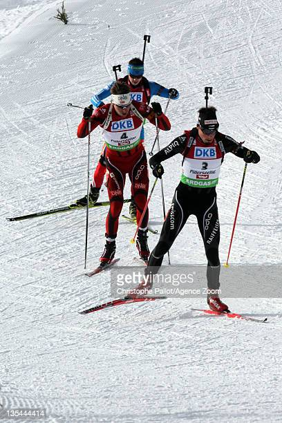 Emil Hegle Svendsen of Norway takes 1st place Benjamin Weger of Switzerland takes 3rd place during the IBU Biathlon World Cup MenÕs Pursuit on...