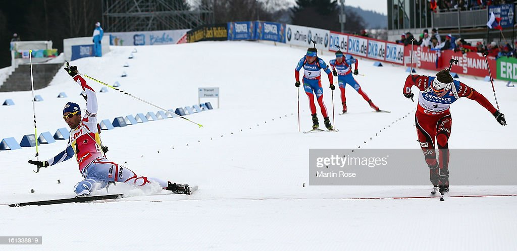 Emil Hegle Svendsen (R) of Norway wins the gold medal after he crosses the finish line before Martin Foucarde (L) of France in the men's 12.5km pursuit event during the IBU Biathlon World Championships at Vysocina Arena on February 10, 2013 in Nove Mesto na Morave, Czech Republic.