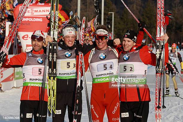 Emil Hegle Svendsen of team Norway celebrates with his team mates Rune Brattsveen Ole Einar Bjoerndalen an Tarjei Boe at the finish area after...