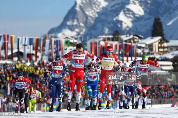 Emil Iversen of Norway Gleb Retivykh of Russia and Max Hauke of Austria compete in the first semifinal run for the Mens' Cross Country Team Sprint...