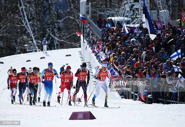 Emil Joensson of Sweden leads the pack in the Men's Team Sprint Classic Semi Final during day 12 of the 2014 Sochi Winter Olympics at Laura...