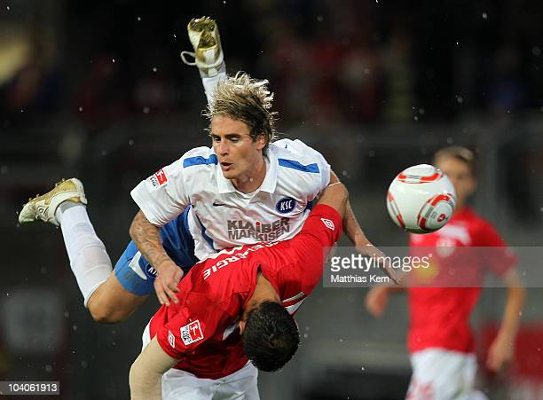 Emil Jula of Cottbus battles for the Ball with Matthias Langkamp of Karlsruhe during the Second Bundesliga match between FC Energie Cottbus and...