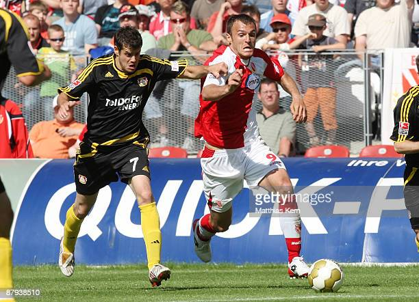 Emil Jula of Cottbus battles for the ball with Tranquillo Barnetta of Leverkusen during the Bundesliga match between FC Energie Cottbus and Bayer 04...