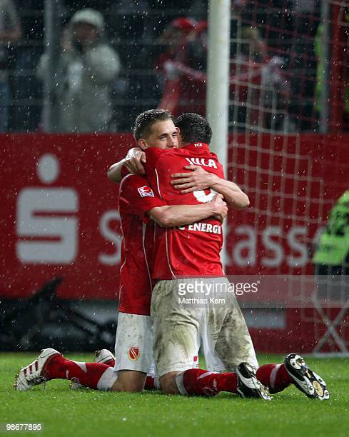 Emil Jula of Cottbus celebrates with team mate Nils Petersen after scoring the fourth goal during the Second Bundesliga match between FC Energie...