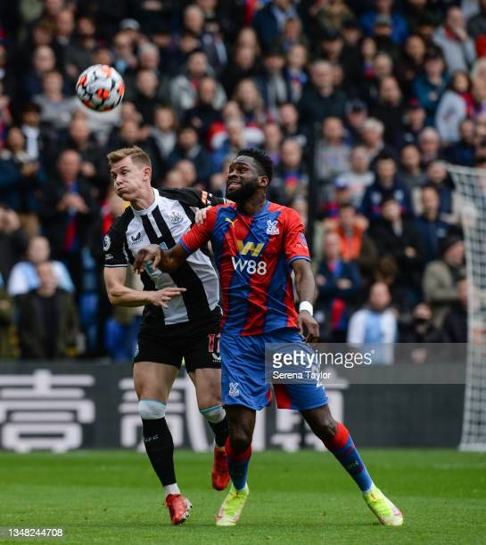 Emil Krafth of Newcastle United FC and Odsonne Edouard of Crystal Palace jostle for the ball during the Premier League match between Crystal Palace...