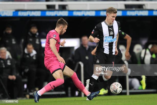 Emil Krafth of Newcastle United in action with Rochdale's Rhys NorringtonDavies during the FA Cup match between Newcastle United and Rochdale at St...