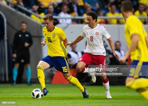Emil Krafth of Sweden and Thomas Delaney of Denmark competes for the ball during the International Friendly match between Sweden and Denmark at...