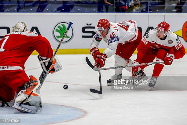 Emil Kristensen of Denmark and Andrei Kostitsyn of Belarus battle for the puck during the IIHF World Championship group B match between Denmark and...