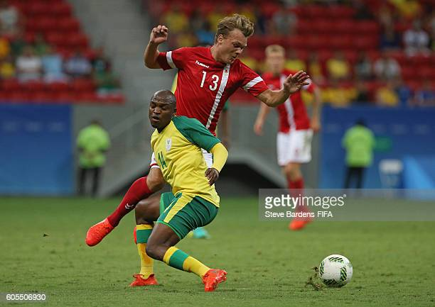 Gift motupa pictures and photos getty images emil larsen of denmark is tackled by gift motupa of south africa during the mens first negle Images