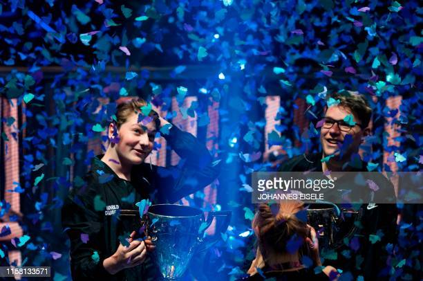 "Emil ""Nyhrox"" Bergquist Pedersen and Thomas ""Aqua"" Arnould pose with their trophies after winning the Duos competition during the 2019 Fortnite World..."