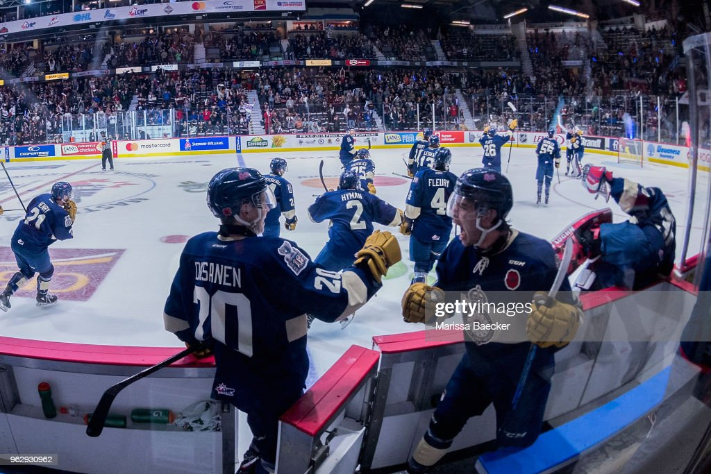 Emil Oksanen #20 of Regina Pats fist bumps a teammate as the buzzer indicates the end of the game and the game 1 win against the Hamilton Bulldogs at Brandt Centre - Evraz Place on May 18, 2018 in Regina, Canada.