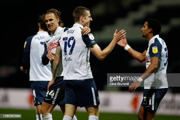 Emil Riis Jakobsen of Preston North End celebrates with team mates Brad Potts and Scott Sinclair of Preston North End after scoring their sides third...
