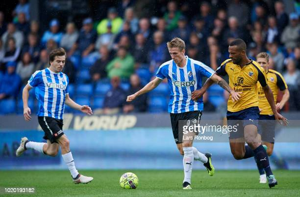 Emil Riis Jakobsen of Randers FC and YawIhle Amankwah of Hobro IK compete for the ball during the Danish Superliga match between Randers FC and Hobro...