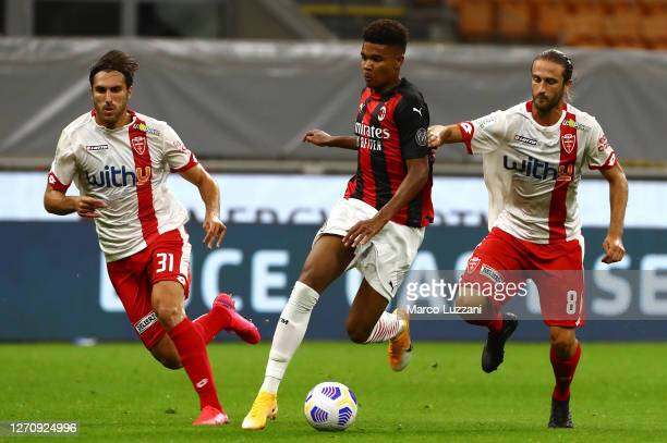 Emil Roback of AC Milan competes for the ball with Andrea Barberis and Mario Sampirisi of Monza during the pre-season friendly match between AC Milan...
