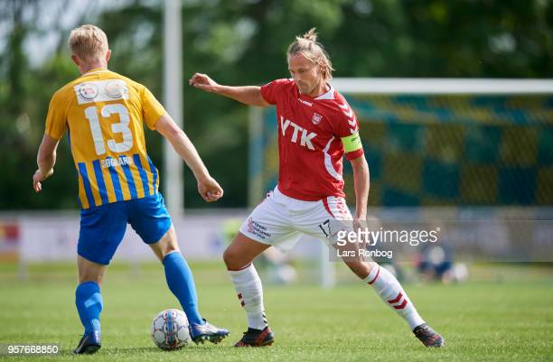 Emil Sogaard of Skive Boldklub and Nicolaj Madsen of Vejle Boldklub compete for the ball during the Danish NordicBet Liga match between Skive IF and...