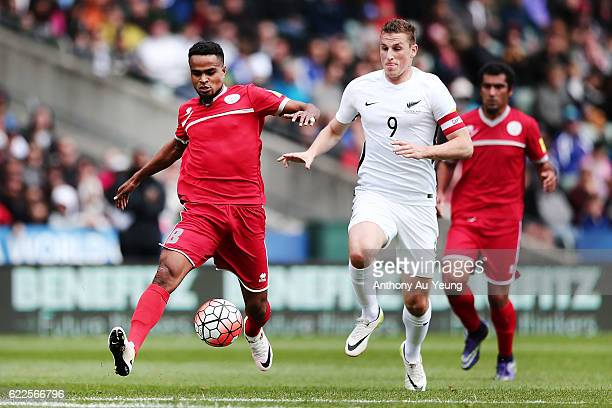 Emile Bearune of New Caledonia competes against Chris Wood of New Zealand during the 2018 FIFA World Cup Qualifier match between the New Zealand All...