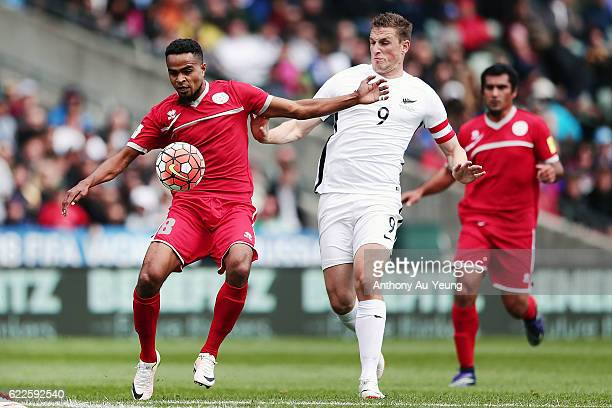 Emile Bearune of New Caledonia holds off Chris Wood of New Zealand during the 2018 FIFA World Cup Qualifier match between the New Zealand All Whites...