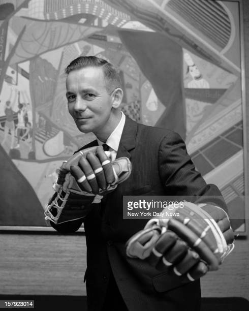 Emile Francis who announced he'd continue as Ranger coach and general manager for the 196667 season illustrates fighting attitude he hopes his...
