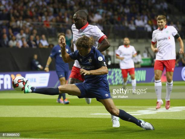 Emile Heskey is tackled by Carles Puyol during the Star Sixe's match between England and Spain in the at The O2 Arena on July 13 2017 in London...