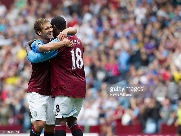 Emile Heskey of Aston Villa celebrates his goal for Aston Villa with team mate Stilliyan Petrov during the Barclays Premier League match between...