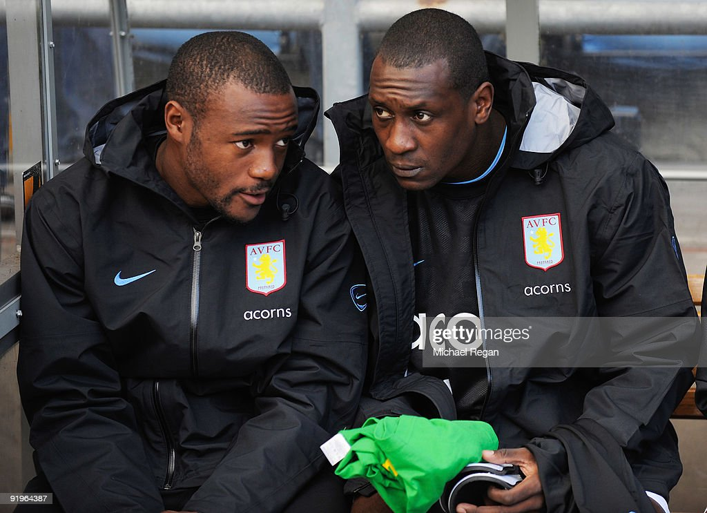 Emile Heskey of Aston Villa (R) in discussion with team mate Nigel Reo-Coker as they sits on the bench prior to the Barclays Premier League match between Aston Villa and Chelsea at Villa Park on October 17, 2009 in Birmingham, England.