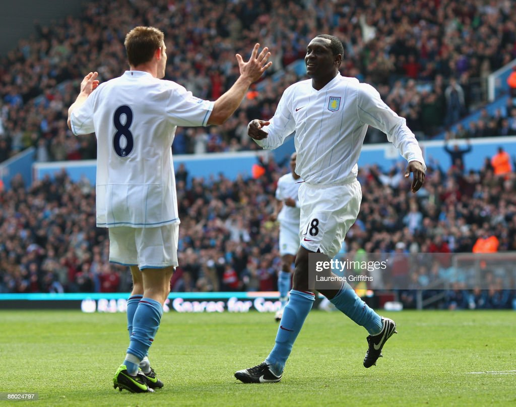 Emile Heskey of Aston Villa is congratulated on scoring the opening goal by James Milner during the Barclays Premier League match between Aston Villa and West Ham United at Villa Park on April 18, 2009 in Birmingham, England