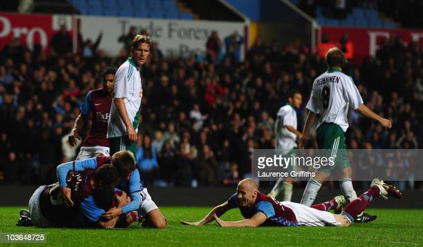 Emile Heskey of Aston Villa is mobbed after scoring the second goal during the UEFA Europa League play off second leg match between Aston Villa and...