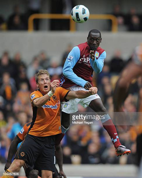 Emile Heskey of Aston Villa outjumps Christophe Berra of Wolves to score to make it 21 during the Barclays Premier League match between Wolverhampton...