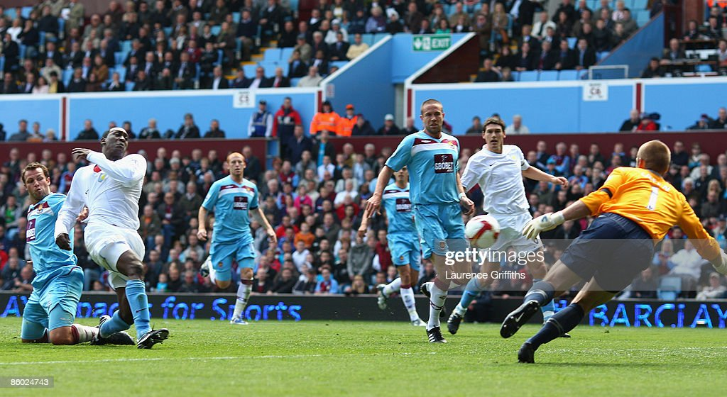Emile Heskey of Aston Villa scores the opening goal past Robert Green of West Ham during the Barclays Premier League match between Aston Villa and West Ham United at Villa Park on April 18, 2009 in Birmingham, England