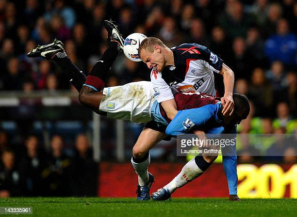 Emile Heskey of Aston Villa tangles with David Wheater of Bolton Wanderers during the Barclays Premier League match between Aston Villa and Bolton...