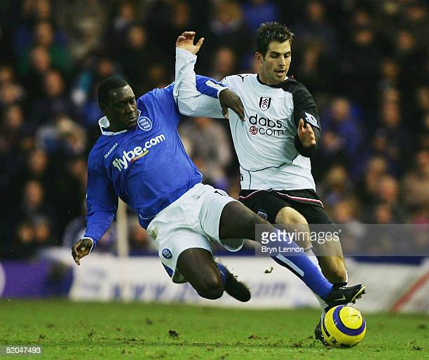 Emile Heskey of Birmingham City tackles Carlos Bocanegra of Fulham during the Barclays Premiership match between Birmingham City and Fulham at St...