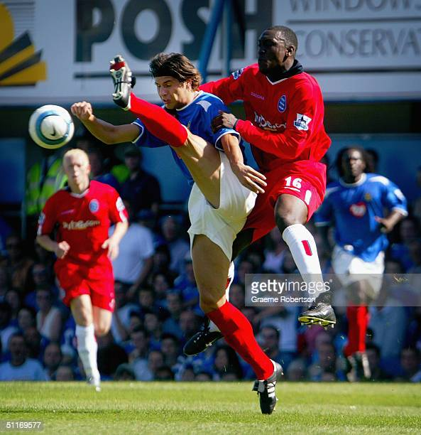 Emile Heskey of Birmingham jumps for the ball for over Dejan Stefenovic of Portsmouth during the Barclays Premiership match between Portsmouth and...