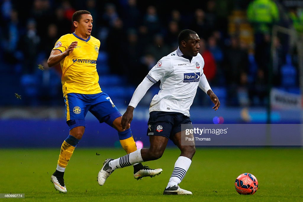 Emile Heskey (R) of Bolton in action with James Tavernier of Wigan during the FA Cup Third Round match between Bolton Wanderers and Wigan Athletic at the Macron Stadium on January 3, 2015 in Bolton, England.