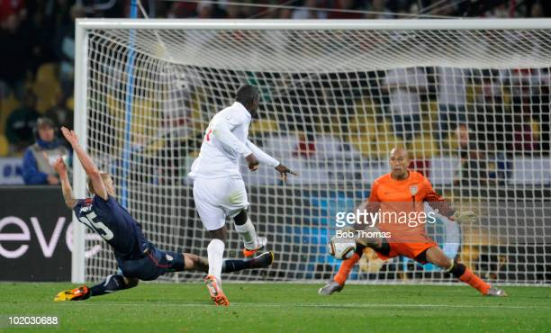 Emile Heskey of England misses his goal chance by hitting the ball directly at USA goalkeeper Tim Howard during the 2010 FIFA World Cup South Africa...