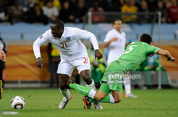 Emile Heskey of England tackles Rafik Halliche of Algeria during the 2010 FIFA World Cup South Africa Group C match between England and Algeria at...