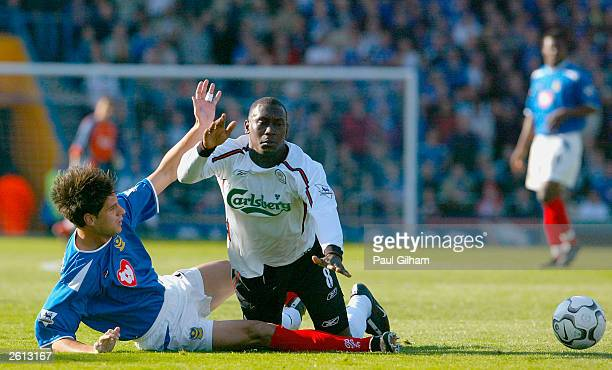 Emile Heskey of Liverpool is tackled by Dejan Stefanovic of Portsmouth during the FA Barclaycard Premiership match between Portsmouth and Liverpool...