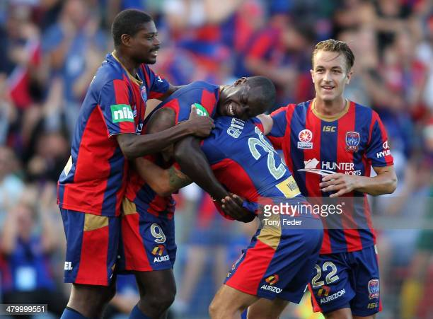 Emile Heskey of the Jets celebrates a goal with team mates during the round 24 ALeague match between the Newcastle Jets and Wellington Phoenix at...