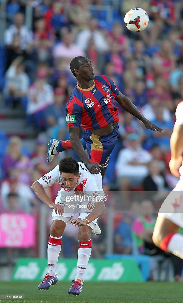 Emile Heskey of the Jets contests a header with Jonatan Germano of the Heart during the round 22 A-League match between the Newcastle Jets and Melbourne Heart at Hunter Stadium on March 8, 2014 in Newcastle, Australia.