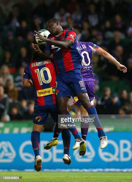 Emile Heskey of the Jets contests for the ball with Bernardo Ribeiro and Liam Miller of the Glory during the round five ALeague match between the...