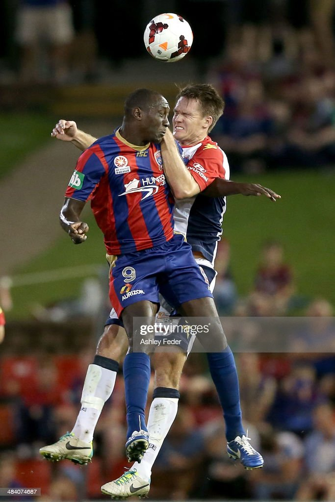 Emile Heskey of the Jets contests the header against Cameron Watson of Adelaide United during the round 27 A-League match between the Newcastle Jets and Adelaide United at Hunter Stadium on April 11, 2014 in Newcastle, Australia.
