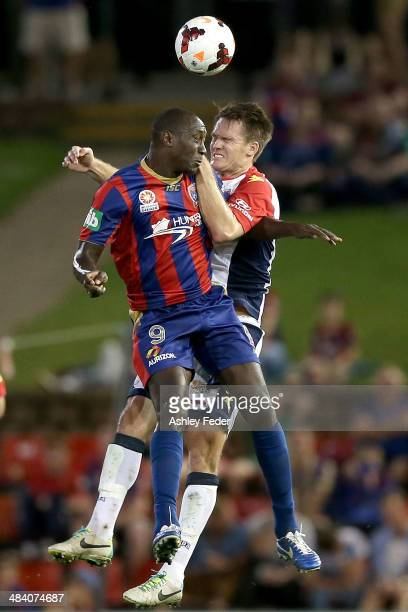Emile Heskey of the Jets contests the header against Cameron Watson of Adelaide United during the round 27 ALeague match between the Newcastle Jets...