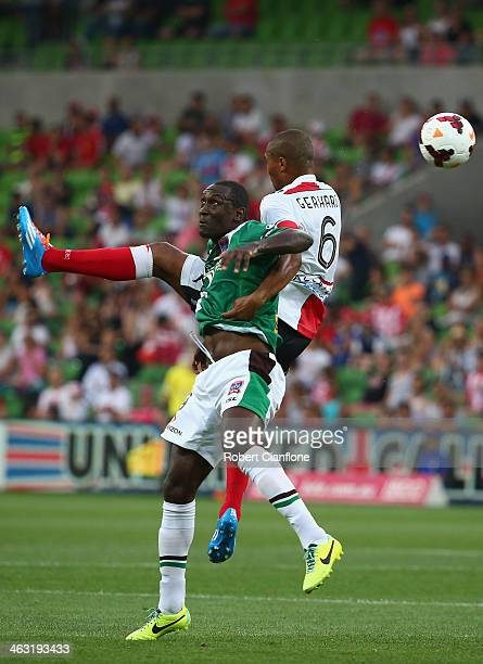 Emile Heskey of the Jets is challenged by Patrick Gerhardt of the Heart during the round 15 ALeague match between Melbourne Heart and the Newcastle...