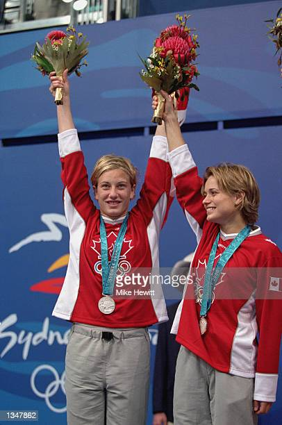 Emile Heymans and Anne Montminy of Canada celebrate their Silver medal win in the Women's Synchronize 10m Final during the Sydney 2000 Olympic Games...