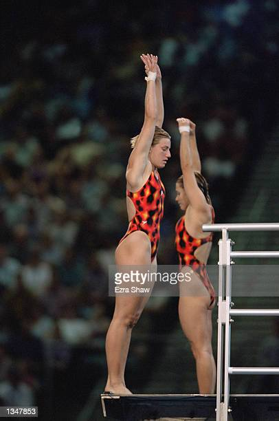 Emile Heymans and Anne Montminy of Canada get ready to perform in the Women's Synchronize 10m Final during the Sydney 2000 Olympic Games on September...