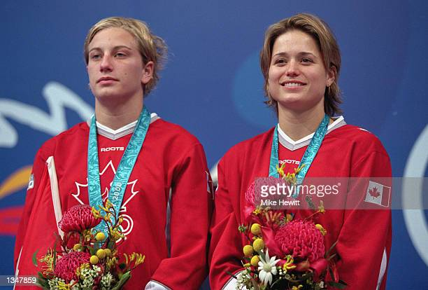 Emile Heymans and Anne Montminy of Canada receive a Silver medal in the Women's Synchronize 10m Final during the Sydney 2000 Olympic Games on...