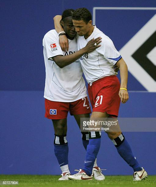 Emile Mpenza celebrates scoring the second goal with Khalid Boulahrouz of Hamburg during the Bundesliga match between Hamburger SV and Hansa Rostock...