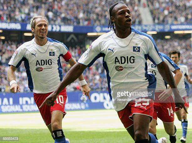 Emile Mpenza of Hamburg celebrates scoring the first goal with team mate Sergej Barbarez of Hamburg during the Bundesliga match between Hamburger SV...